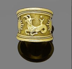 A gold ring, by Elizabeth Gage, Gold Band Ring, Gold Bands, Band Rings, Capricorn Sign, Aries, Jewelry Box, Fine Jewelry, Mythological Creatures, Carat Gold