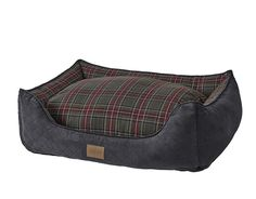 Inspired by vintage tartans and plaids still woven in Pendleton's American mills, this handsome bed offers your dog an irresistible nook with support on three sides. The streamlined silhouette looks great and offers a comforting sense of security your dog is sure to love. The unique channel liner stuffed with high-loft memory fiber polyester fill tops an orthopedic foam base, creating a dual-comfort supportive cushion. In gray. Polyester/acrylic bolster and sleep top. Polyester fill....