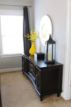"""Love the black furniture and black/gray/yellow theme in this room. Wall color is """"Knitting Needles"""" by Sherwin Williams"""