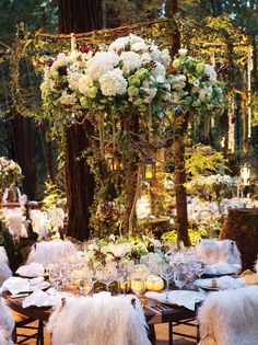 Hand-carved chairs were each topped with a sheepskin rug at an enchanted wedding in Big Sur, CA