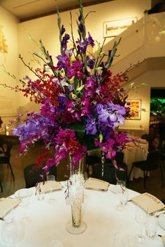 #weddingflowers #weddings www.lavenderhillflorals.com Tall Wedding Centerpieces. Purple and red orchids. Mercury glass