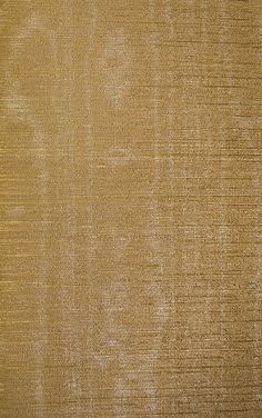 Watered Silk A copper textured vinyl wallcovering imitating silk with a silvery water mark effect.