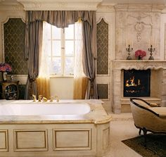 Bathroom Remodeling Must-Haves -- Luxury bathtub, floor-length curtains, and fireplace