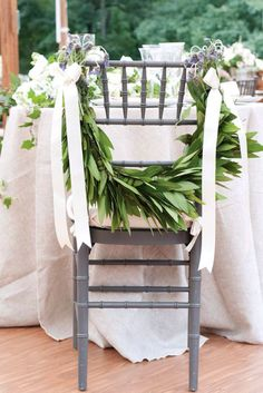 Wreath of leaves and delicate blooms - perfect for an outdoor Grecian or Italian theme wedding. #weddingchair #chairdecor. Source: beautiful blooms.