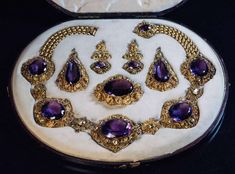 For Sale on 1stdibs - This magnificent antique parure from the late Georgian era, circa 1830, features large faceted amethysts accented by green chrysoberyls set in ornate filigree