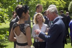 Prince Charles, Prince of Wales chats with Tara-Brigitte Bhavnani (L) a Canadian dancer with the Royal Ballet during a reception for Canadians living and working in the UK at St James's Palace on May 14, 2014