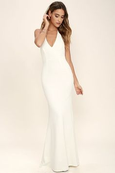 Work your magic in the Love Potion Ivory Lace Halter Maxi Dress! A gorgeous lace overlay shapes a plunging halter neckline with double covered button closure and princess seams. Fitted bodice gives way to a stretchy, mermaid maxi skirt. Hidden back zipper and clasp.