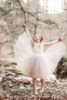 """""""Dance like no one is watching"""" is the perfect way to describe how your  sweet angel will feel dressed in our new Siobhan gown. As she prances  around, she will catch the attention of anyone nearby with this tutu dress,  full of flair and character. Layers of blush and lavender tulle high  quality tulle have been sewn together for the ultimate princess look that  is accompanied by a floral printed halter style bodice with an elastic  casing across the back to provide a snug and comfortable…"""