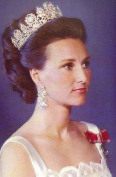 "A young Queen Sonia of Norway wearing the ""Tiara Desirée"", owned by the Norwegian royals. A neoclassical tiara representing floral garlands and wreaths of laurel. The name refers to Desiree Clary, who was Queen of Sweden by her marriage with King Charles XIV."