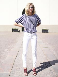 Tine Andrea of The Fashion Eaters in a striped top, white denim, and burgundy sandals