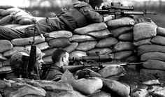 Battle of Khe Shan, 1968: US Marines defending against regular NVA troops deploy their M16s and Starlight scopes on the perimeter.