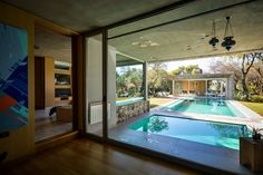 04 a pool is positioned between the two structures, bordered by wooden decking - DigsDigs