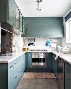 Teal cabinetry, wall to wall vent hood