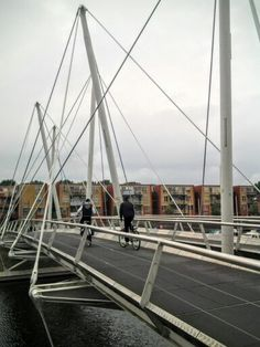 Bridge Almere -the Netherlands;  This bridge knits together its surroundings by…
