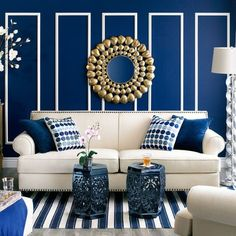 Blue and White Livingroom. Love the paneling and the blues might take away the gold mirror though to ornate for my taste.