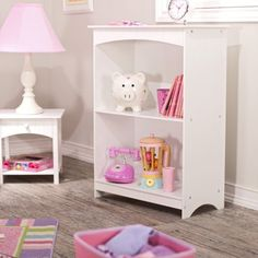 What We Like About the Nantucket BookcaseThis Nantucket White Bookcase is perfect for storing books trinkets and other treasures. With two wide generous shelves an arched top and charming wainscoting detail this is a great and functional accessory for every kid's room. The bookcase is made from durable wood composite finished with a white non-toxic color. Dimensions: 24W x 11.5D x 32H inches.About KidKraftKidKraft is a leading creator manufacture