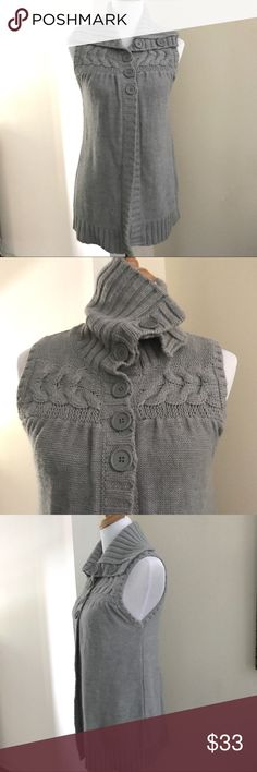 """Liv for Anthropologie Sleeveless button sweater This sweater by Liv for Anthropologie has adorable big buttons down half of front for closure and up the large collar.  wear buttoned up for a cozy turtleneck look or open and folded down (see pics) above the bust a large cable knit pattern. This sweater measures 19"""" between underarm and 28"""" length from shoulder. Anthropologie Sweaters"""