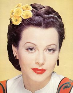 Hedy Lamarr great color photo of her. Love the daises in her hair!