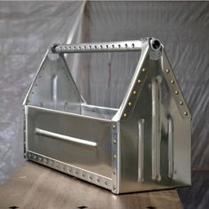 Aluminum sheet metal toolbox, aircraft rivets, cross-drilled handle, bead rolled panels. A fun, handmade project.