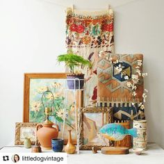 From @littledogvintage ・・・ Pretty stoked on today's flea market haul. Items will be listed in the shop this week.  Pictured: cotton textile from India / kilim throw pillow / oriental hand painted vase / bamboo basket / assorted small studio pottery vessels / wood fish decoy / framed Mexican watercolor / copper plated cat figurine / maple hand turned vessel / copper and green enamel ring dish / French terra cotta lamp / wire plant stand / Russian doll box / Mexican print / abstract daisy…