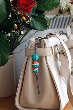 Hand-painted wood beads with acrylic paints, cord is suede leather, metal ring. Beads measure 20 mm, gray suede leather, metal ring 30 mm Length keychain approx 7 cm Thanks for visiting my shop! Painted Wood, Hand Painted, Painting On Wood, Bucket Bag, Watermelon, Beads, Trending Outfits, Unique Jewelry, Handmade Gifts