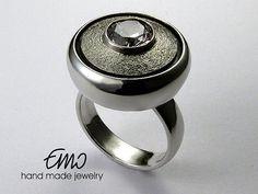Unique silver ring. Handmade jewelry. White zirconia.