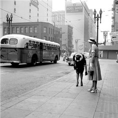 VIVIAN MAIER / SELECTED IMAGES /  BUS AND TWO WOMEN, LOS ANGELES, CA. 1955