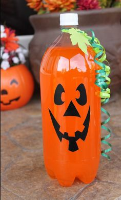 Instead of using the soda, I think I might just collect 2 liter bottles, add water and food coloring. That way the soda doesn't go flat or get wasted.  Or a bottle of orange soda. | 24 Surprisingly Easy Halloween Party DIYs