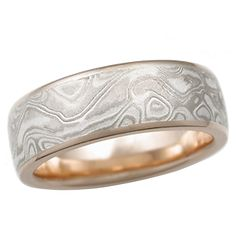 White Mokume Wedding Band with Rose Gold, 6mm - This mokume gane is made up of layers of 14k palladium white gold and sterling. The contrast shows up very nicely with a matte surface. - Light/medium etch. Matte finish. Flush, micro, high polish edges and 14k rose gold liner. Size 6. 6mm wide.