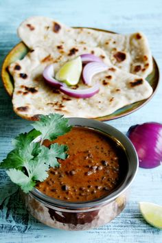 Dal Makhani - Indian Dal (lentils) Makhani (butter) is a savory blend of lentils, kidney beans, Ginger, Garlic, Garam Masala, Tomato paste, cream and delicious herbs and spices.
