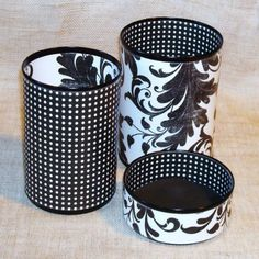 Use scrapbook paper applied to oatmeal containers, tuna tins, etc. to make ugly containers into something pretty to use somewhere in the home for organizing. I would have NEVER thought to reuse a tuna can, but it looks like the perfect size!!