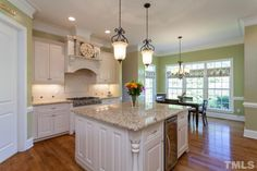 I love this kitchen.  The cabinet  color, wall color and the lights.