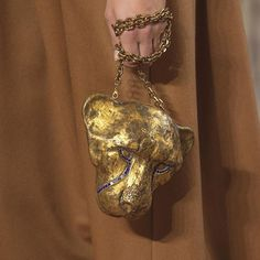 Take a closer look at the second #minaudière seen on the #ValentinoHauteCouture #FallWinter1718 Show created in collaboration with artist @HarumiKlossowskadeRola: a cheetah that stands for pride but in ancient Egypt was also associated to regality and recovery.  via VALENTINO OFFICIAL INSTAGRAM - Celebrity  Fashion  Haute Couture  Advertising  Culture  Beauty  Editorial Photography  Magazine Covers  Supermodels  Runway Models