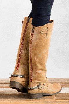 Rustic and moto meet in perfect harmony to create this too fab riding boot. The Canyon Riding Boot by Madden Girl boasts soft, gently distressed faux leather, a stacked heel, almond toe, buckles at the topline and at the ankle, wrap around chain harness and BONUS: an exposed back zipper flanked in hot red. With a cozy vest and ponte pants the Canyon riding boot will make a scene in your wardrobe.
