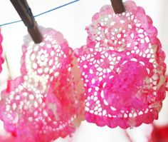 Toddler style painted doily hearts for a Valentine window