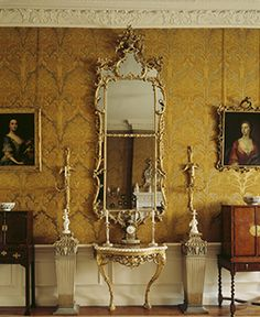 Dyrham ~The interior of the Drawing Room with its gilt mirror and side table and 18th Century, Italian designed wallpaper.