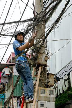 A maze of wires . Hanoi, Vietnam