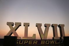 """""""A Super Bowl XLVII sculpture sits on a barge along the Riverwalk [at sunrise], Saturday, Feb. 2, 2013, in New Orleans. The Baltimore Ravens play the San Francisco 49ers in NFL football's Super Bowl XLVII on Sunday."""""""