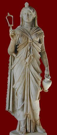 Roman statue of goddes Isis holding a a bucket and a sistrum, ritual implements used in her worship. Marble, 2nd century CE. On display at Musei Capitolini, Rome