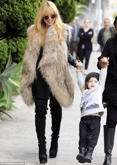 Rachel Zoe. Love her style and her clothing line!