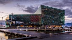 The Harpa Concert Hall is a beautiful building in Reykjavík the capital city of Iceland. The structure consists of a steel framework with geometric shaped glass panels of different colours. Each panel of glass shimmers with a coloured light which resembles the look of the northern lights!  http://ift.tt/1N7X5yM  #theglobewanderer #latepost #amazing #photo #awesome #photographer #beautiful #instagood #wow #picoftheday #photooftheday #architecture #mystopover #photodaily #photogram #iceland…