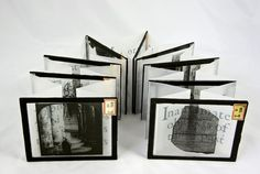 Windows I by Margaret Suchland • 3.25 x 6 x 10 Found Object. Positive photographic glass plates from early 20th c. hinged with pages of digitally printed vellum paper.