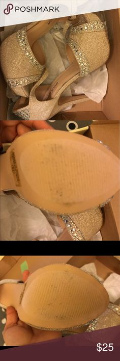 Champagne sparkle heels Never been worn. The black marks on the bottom was from store try ons (and dust lol). Shoes Heels