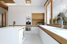 Idee cucina moderna bianca con accenti in legno di quercia