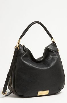 Love love love this leather purse.... Reminiscent of Jennifer Aniston's Tom Ford zipper bag.
