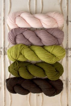 The Yarn for Garden House Baby Blanket kit includes 8 skeins of O-Wash Fingering - 1 skein each of Colors A & E, and two skeins each of Colors B, C & D. Each kit includes enough yarn to make either th