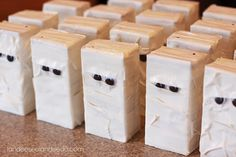 Mummy juice box army made with white duct tape and googly eyes.  I can hardly stand it.