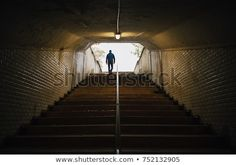 Man walking up the stairs of an old tunnel in the city. Walking Stairs, Stock Foto, Homecoming, Crime, Concept, Inspiration, Image, Pictures, Biblical Inspiration