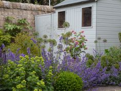 garden shed with utility area and herbaceous planting edinburgh garden by goose green design