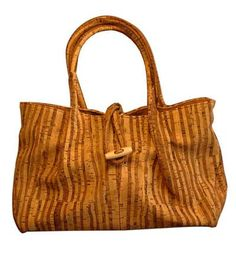 """This beautiful two handled cork purse features - Inside zip pocket; Cell phone/ multifunction pocket; Zip-top closure with decorative hook and eye button strap; Two 13"""" Rolled Straps 5"""" Drop - Cork Ve"""